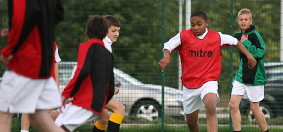House Teams playing football at The JCB Academy